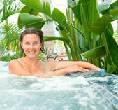 Attractive young woamn relaxing in a Jacuzzi — Stock Photo