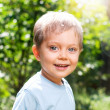 Boy in the summer park — Stock Photo
