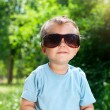 Boy Sunglasses in the summer park — Stock Photo
