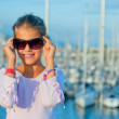 Stock Photo: Portrait of a girl in the background of yachts