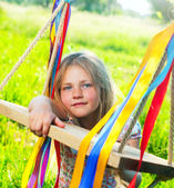 Young girl on swing — Stock Photo