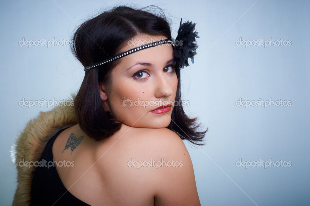 Retro portrait of a young woman in studio — Stock Photo #5817307
