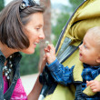 Boy with mother in the park — Stock Photo #5824387