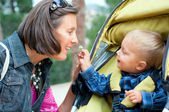 Boy with mother in the park — Stock Photo