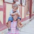 Brother and sister outdoors in city — Stock Photo