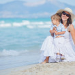 Young mother with her son on beach vacation — Stock Photo