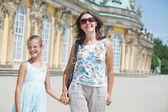 Tourists walking in Sans Souci — Stock Photo