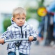Little cute boy on the bike in city. — Stock Photo
