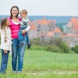 Travelers. Young mother with her two children — Stock Photo #6741024
