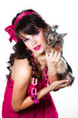 Beautiful girl wearing pink with small dog on white background — Stock Photo