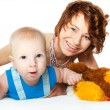 Stock Photo: Baby boy with pretty mother