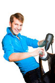 Hairdresser man working with hair dryer on isolated white — Stock Photo