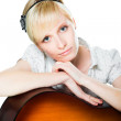 Attractive young blond woman with guitar — Stock Photo