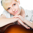 Blond woman with guitar on isolated white — Stock Photo
