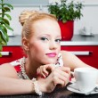 Girl  with cup of coffee in interior of kitchen — Stok fotoğraf