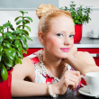 Girl with cup of coffee in interior of kitchen — Stock Photo #5873506