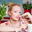 Stock Photo: Sexy girl with cup of coffee in interior of kitchen