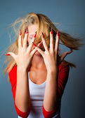 Girl with fashionable design of nails — Stock Photo