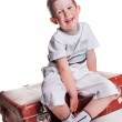 Lovely boy with vintage suitcase on white background — Stock Photo #5910635