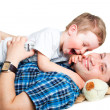 Happy father playing with his laughing son on isolated white — Stock Photo