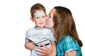 Careful mother gently kissing her son on isolated white — Stock Photo