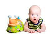 Cute baby with toy caterpillar on isolated white — Stock Photo