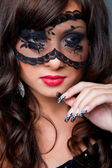 Attractive brunette with acy mask on eyes — Stock Photo