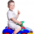 Gesticulating boy with colorful car — Stock Photo #6012662