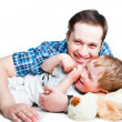 Happy father playing with his laughing son on white — Stock Photo