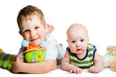 Cute brothers with toy caterpillar on isolated white — Stock Photo