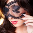Attractive brunette girl with lacy mask on her eyes — Stock Photo #6118201
