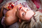 Lying woman with pomegranate — Foto de Stock