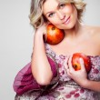 Blonde woman with pomegranates on gray — Stock Photo