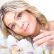 Blonde woman with orchid on white — Stock Photo #6297078