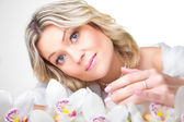 Blonde woman with orchid on white — Stock Photo
