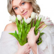 Beautiful woman with spring tulips on isolated white — Stock Photo #6324777