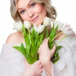 Beautiful woman with spring tulips on isolated white — Stock Photo