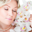 Blonde woman with orchid on isolated white — Stock Photo #6324807