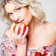 Blonde woman with pomegranate on gray — Stock Photo #6324837