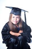 Sevimli kız mezuniyet elbise izole beyaz — Stok fotoğraf