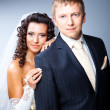 Just married groom and bride on blue — Stock Photo