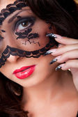 Beautiful lady with lacy mask on eyes — Stock Photo