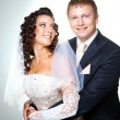 Stock Photo: Just married groom and bride on grey