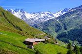 Mountain hut and Stubai Alps — Stock Photo
