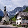Church and old house in the Alps — Stock Photo