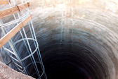 Concreted hole under the ground — Stock Photo