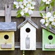 Stock Photo: Three birdhouses on old wooden fence
