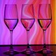 Three wine glass with colorful background — Stock Photo