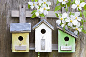 Three birdhouses on old wooden fence — Stok fotoğraf
