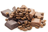 Heap of coffe beans and chocolate on white — Stock Photo